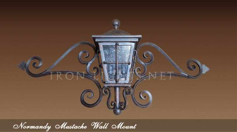 Outdoor lighting mustache wall mount